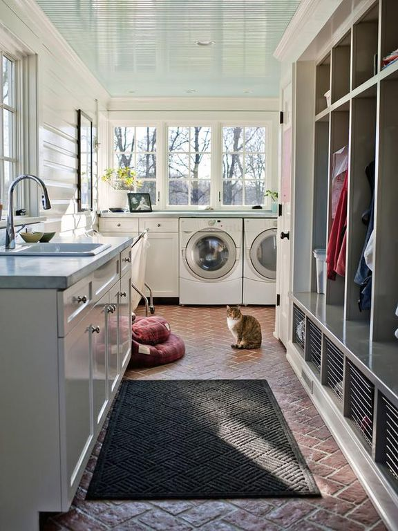 Cottage Laundry Room with Brick floors, Front load washing machine and dryer, Painted wood walls, Painted wood ceiling