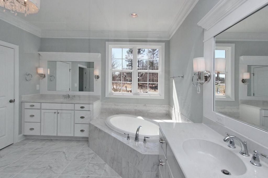 "Traditional Master Bathroom with Kohler k-1147-0 white pro flex collection 60"" drop in soaking bathtub, Chandelier, Flush"