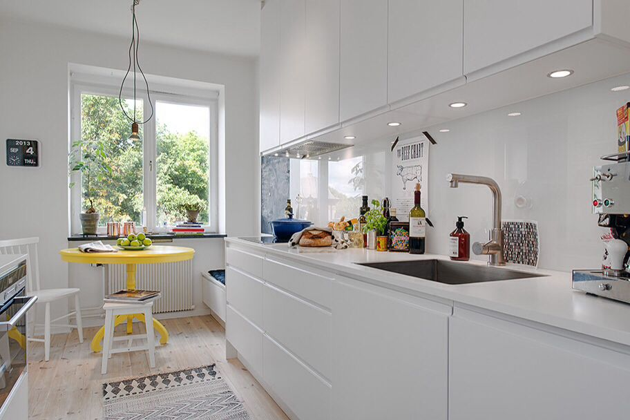 Contemporary Kitchen with Inset cabinets, Casement, electric cooktop, Undermount sink, Design within reach salt chair, Galley