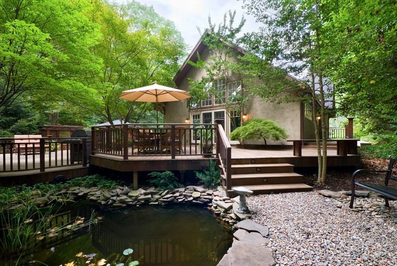 Craftsman Deck with Pathway, exterior stone floors, Casement, Pond, picture window, Deck Railing, French doors
