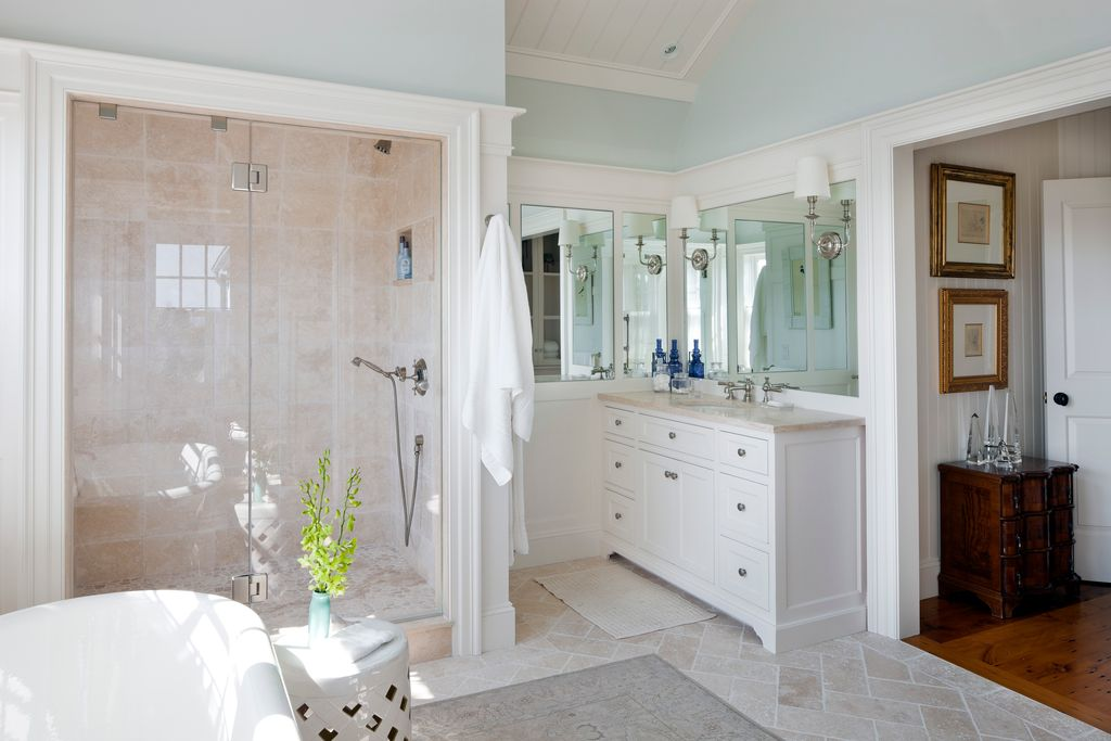 Traditional Master Bathroom with Inset cabinets, picture window, frameless showerdoor, Limestone counters, can lights, Shower