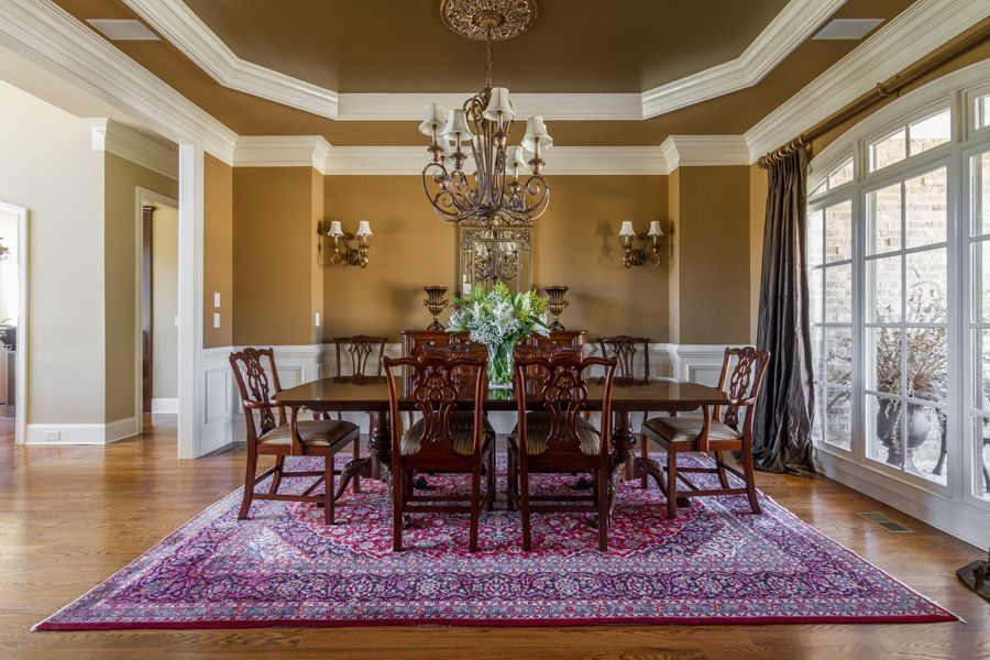 Traditional Dining Room with Standard height, Wall sconce, Wainscotting, Crown molding, Hardwood floors, Chandelier