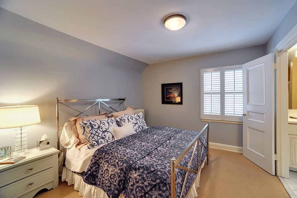 Traditional Master Bedroom with Standard height, specialty door, can lights, flush light, Carpet, double-hung window
