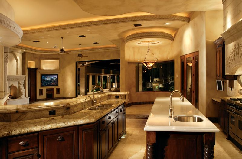 Mediterranean Kitchen with Complex granite counters, High ceiling, stone tile floors, full backsplash, Complex Granite
