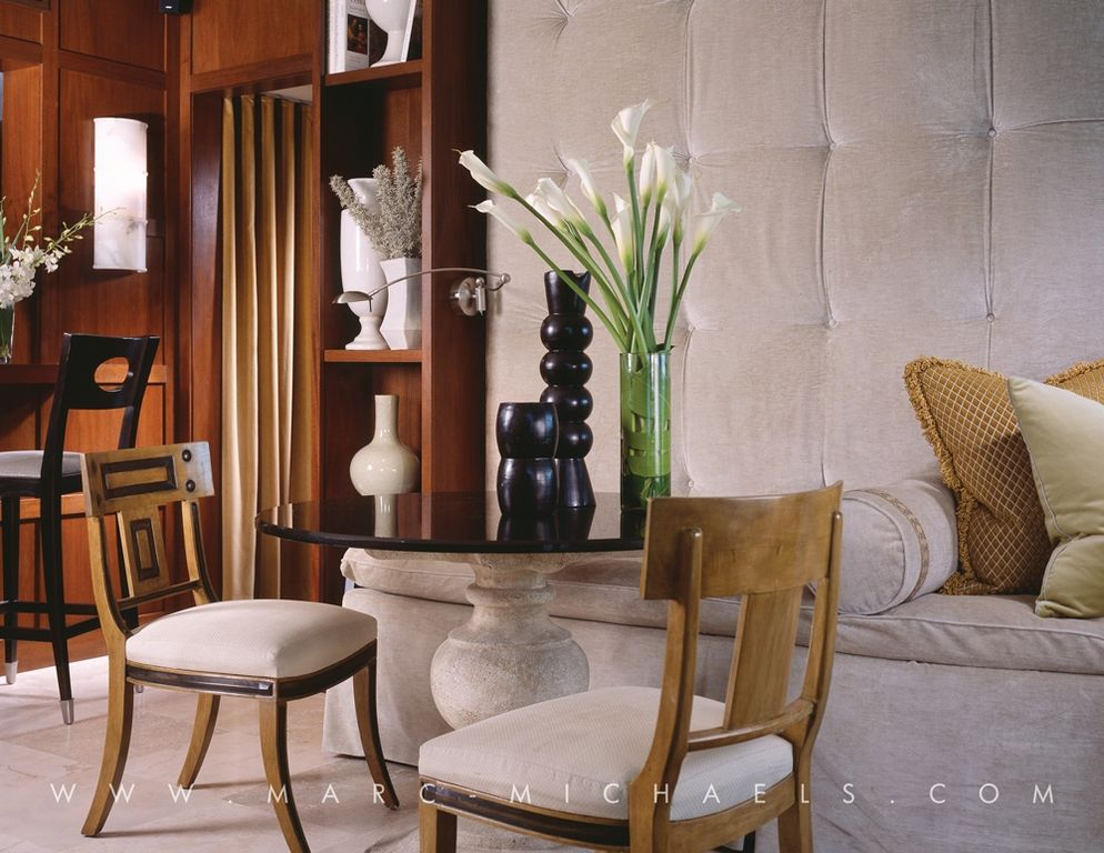 Contemporary Dining Room with Standard height, Built-in bookshelf, stone tile floors, sandstone tile floors, Wall sconce