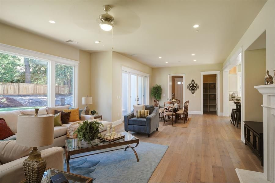 Traditional Great Room with French doors, Hardwood floors, Cement fireplace, Standard height, picture window, Fireplace