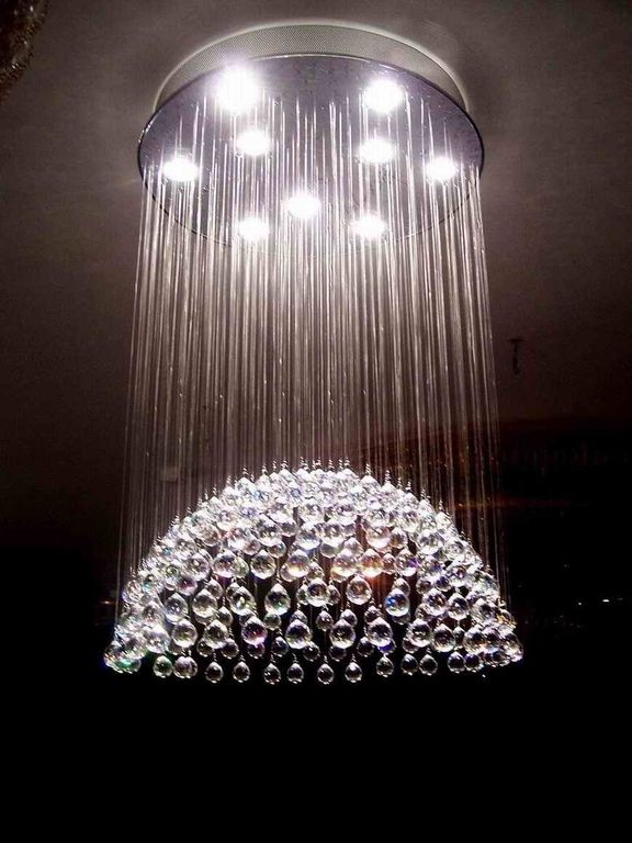 Art Deco Dining Room With Modern Light Fixture