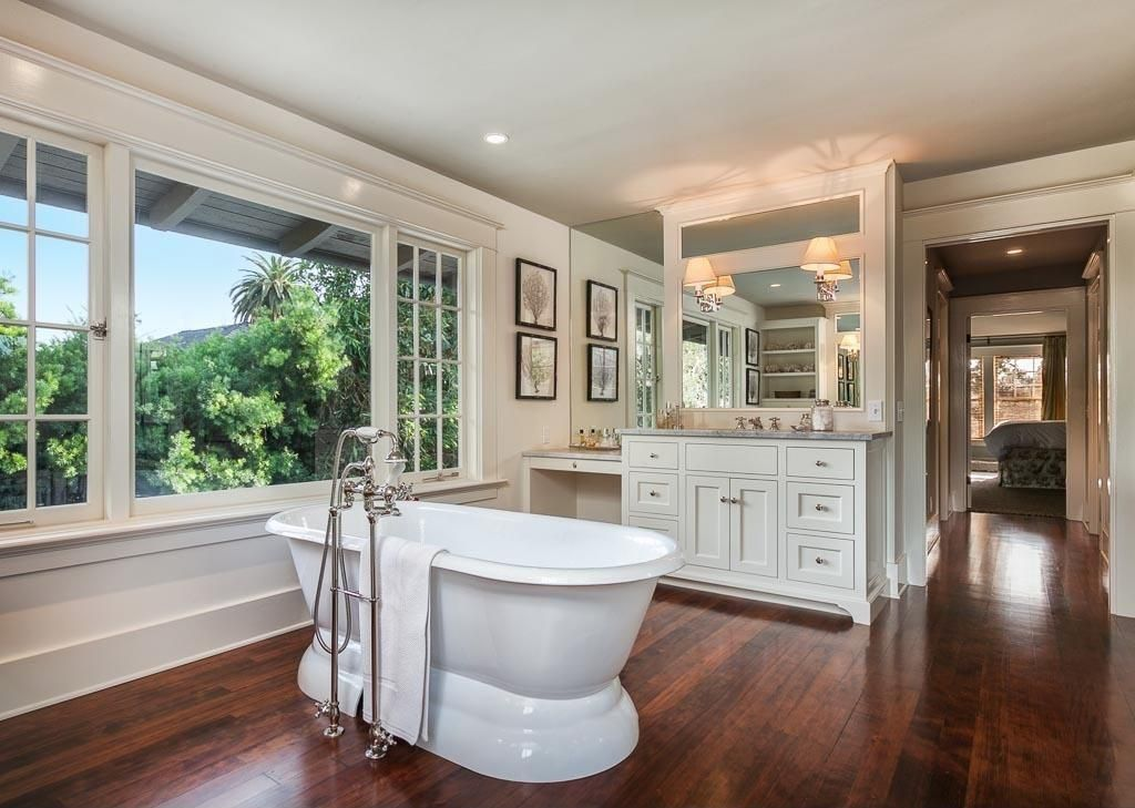 Traditional Master Bathroom with picture window, Freestanding, Inset cabinets, Hardwood floors, Standard height, Casement