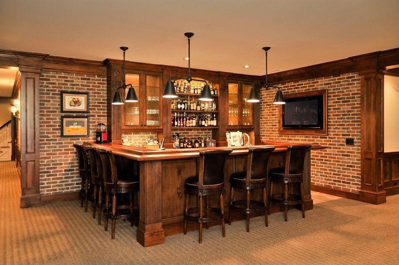 Craftsman Bar with interior brick, Carpet, Pendant light, Crown molding, Built-in bookshelf, can lights, Standard height