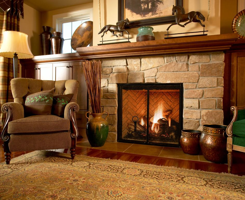 Traditional Living Room with Fireplace, Standard height, Hardwood floors, picture window, Built-in bookshelf, stone fireplace