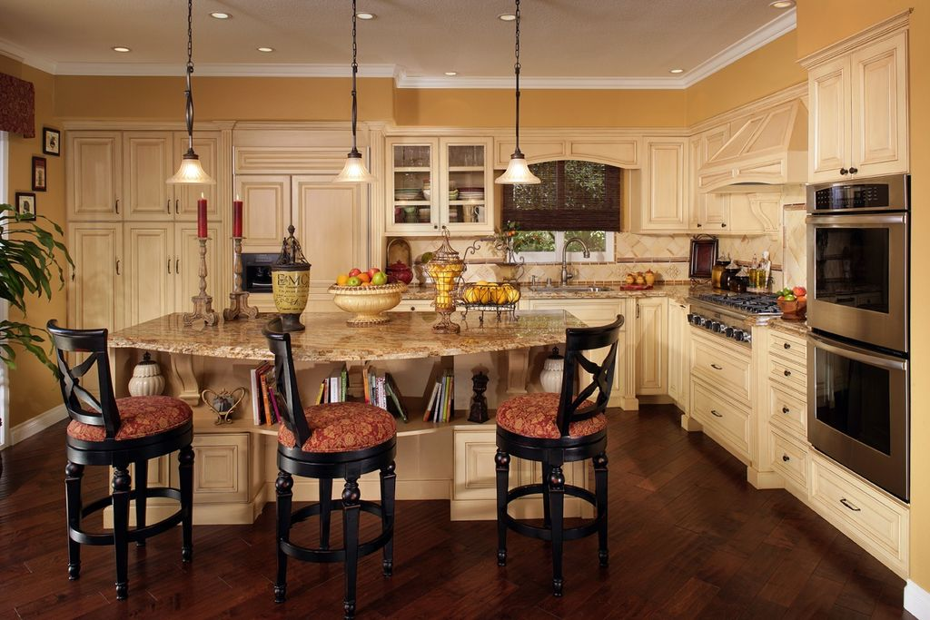 Traditional Kitchen with L-shaped, Simple granite counters, Built-in bookshelf, Breakfast bar, Stone Tile, Kitchen island