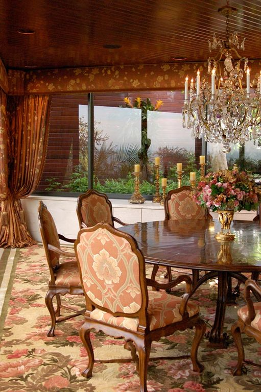 Traditional Dining Room with Standard height, Chandelier, Carpet, picture window, can lights, interior wallpaper