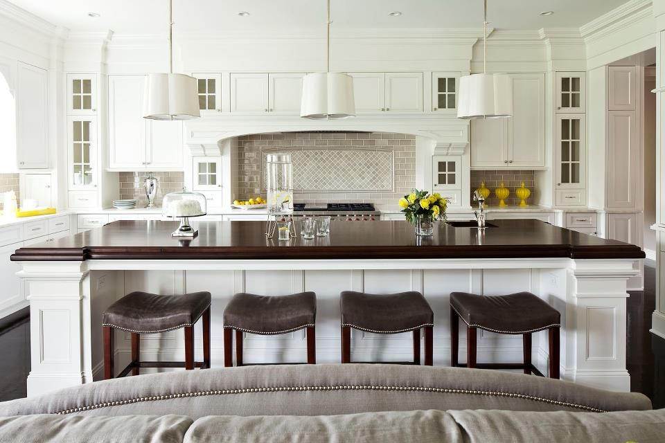 Contemporary Kitchen with Undermount sink, full backsplash, Wood counters, Complex marble counters, L-shaped, Custom hood