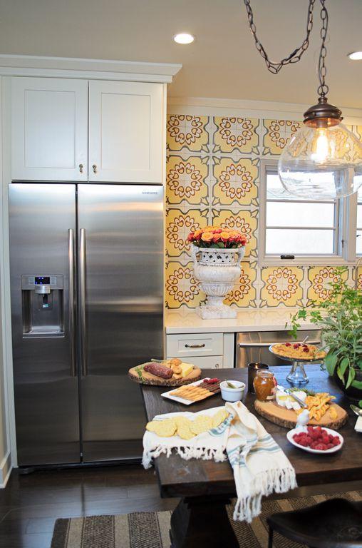 Mediterranean Kitchen with Large Ceramic Tile, Crown molding, Flush, Wood dining table, Quartz countertop, Kitchen island