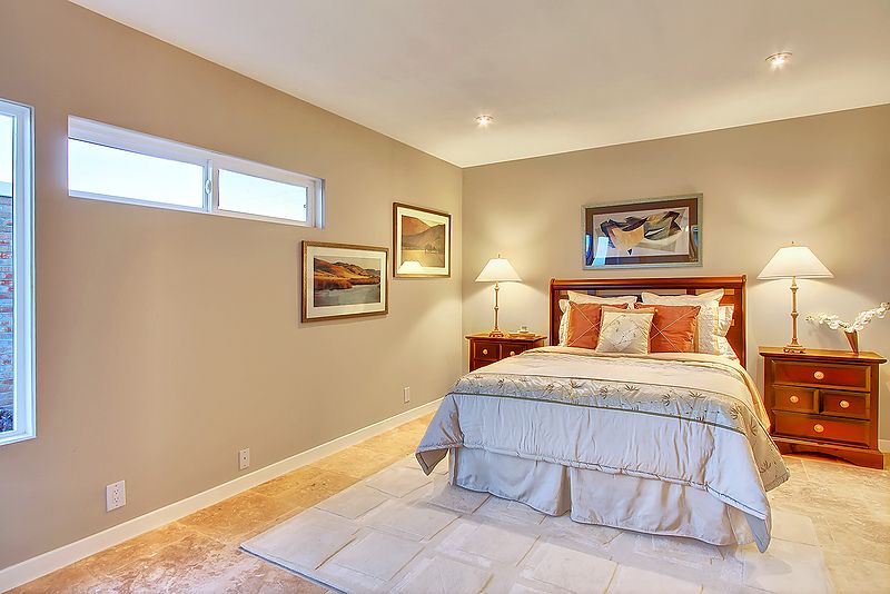 Traditional Master Bedroom with Standard height, limestone floors, Casement, picture window, can lights
