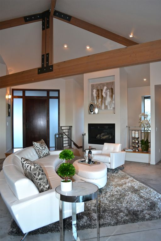 Modern Living Room with Fireplace, metal fireplace, picture window, Wall sconce, flat door, can lights, Transom window