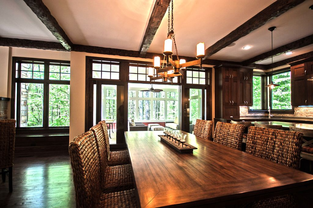 Craftsman Dining Room with Transom window, picture window, Standard height, Hardwood floors, Exposed beam, French doors