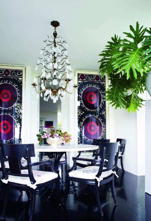 Contemporary Dining Room with Chandelier, Laminate floors, Standard height