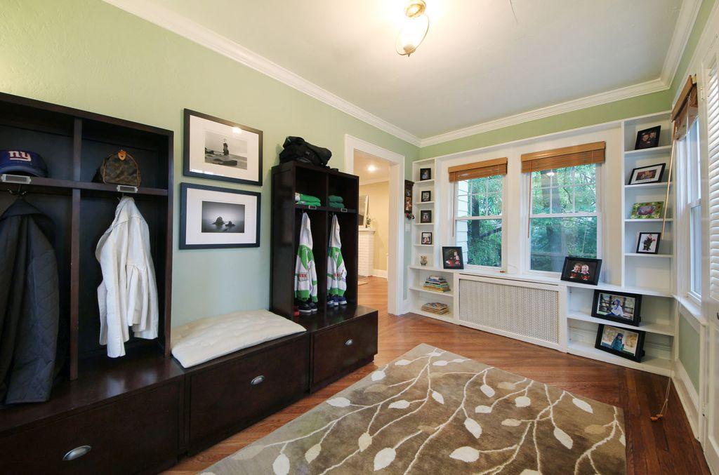 Traditional Mud Room with Hampton Bay Caramel Simple Weave Bamboo Roll-up Shade, Hardwood floors, Built-in bookshelf