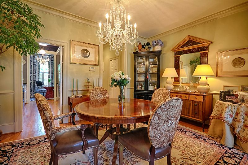 Traditional Dining Room with Crown molding, Standard height, six panel door, Chandelier, Chair rail, Built-in bookshelf