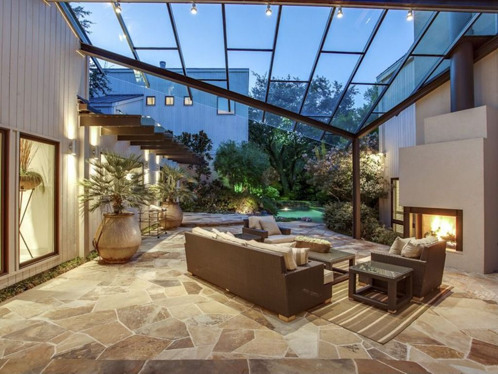 Contemporary Patio with exterior stone floors, Skylight, picture window
