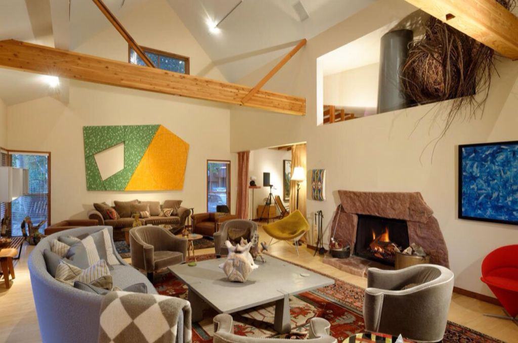 Eclectic Great Room with stone fireplace, picture window, French doors, Hardwood floors, flush light, double-hung window