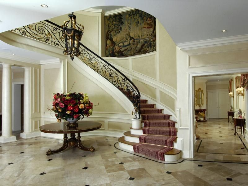 Traditional Staircase with High ceiling, Wainscotting, Crown molding, curved staircase, Hardwood floors