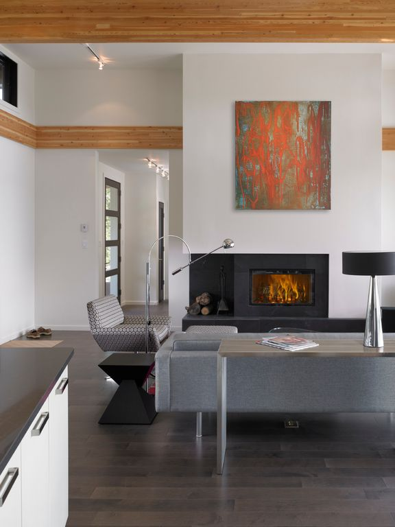 Contemporary Great Room with insert fireplace, picture window, flush light, Laminate floors, Fireplace, Standard height