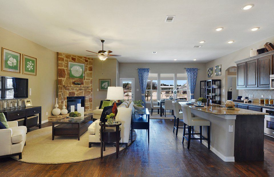 Contemporary Great Room with Casement, Built-in bookshelf, Standard height, Ceiling fan, stone fireplace, Hardwood floors