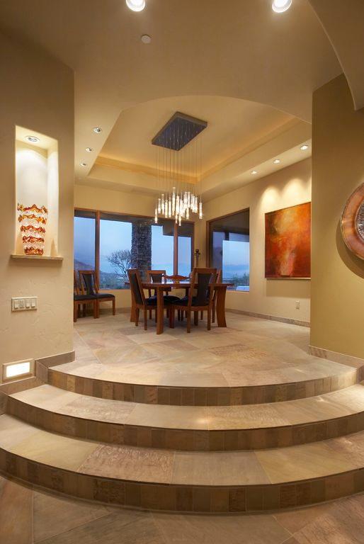 Contemporary Dining Room with sandstone tile floors, can lights, stone tile floors, Chandelier, Paint 1, High ceiling