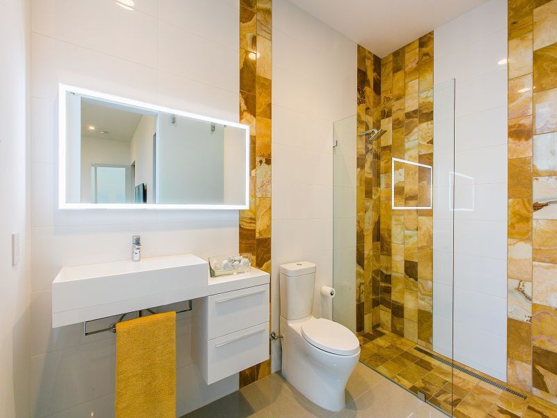 Contemporary 3/4 Bathroom with can lights, Standard height, Wall Tiles, frameless showerdoor, limestone tile floors, Shower