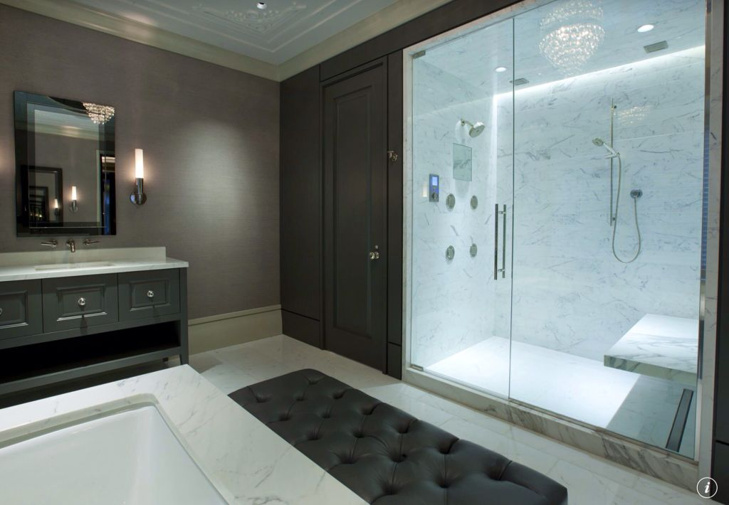 Contemporary Master Bathroom with Sunpan Modern Viceroy Faux Leather Bench, Bathtub, can lights, Complex marble counters