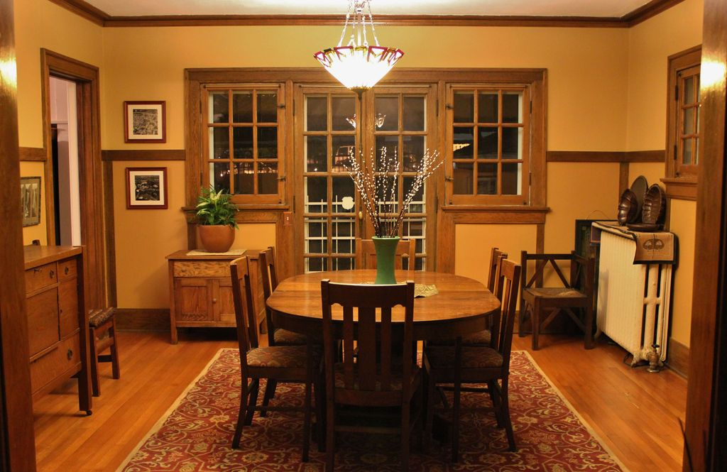 craftsman dining room with wainscoting bowl pendant