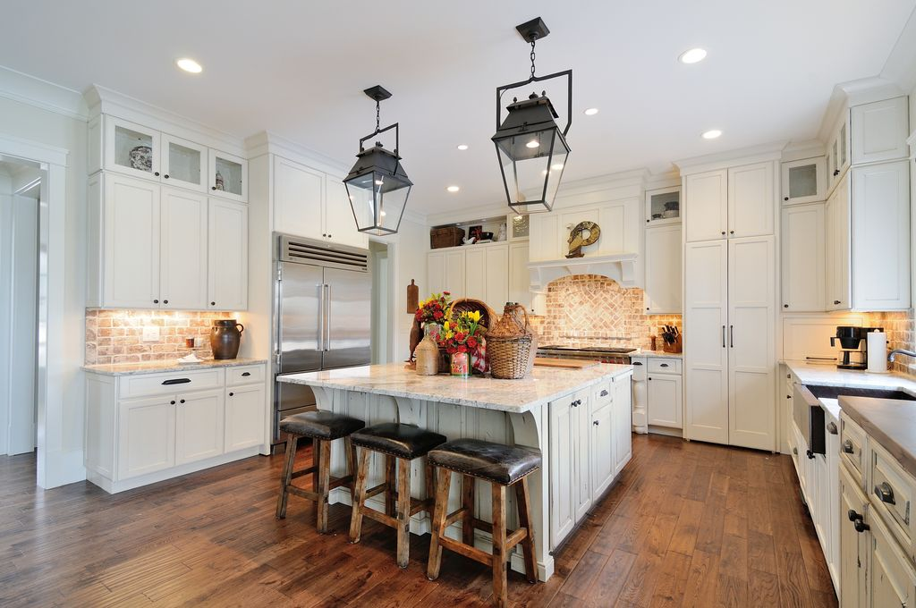 Country Kitchen with Standard height, Pendant light, Built In Refrigerator, U-shaped, full backsplash, can lights, Slate Tile
