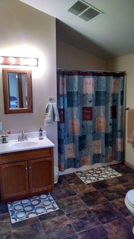 Traditional Full Bathroom with Bathtub, Flat panel cabinets, Full Bath, shower bath combo, curtain showerdoor, specialty door