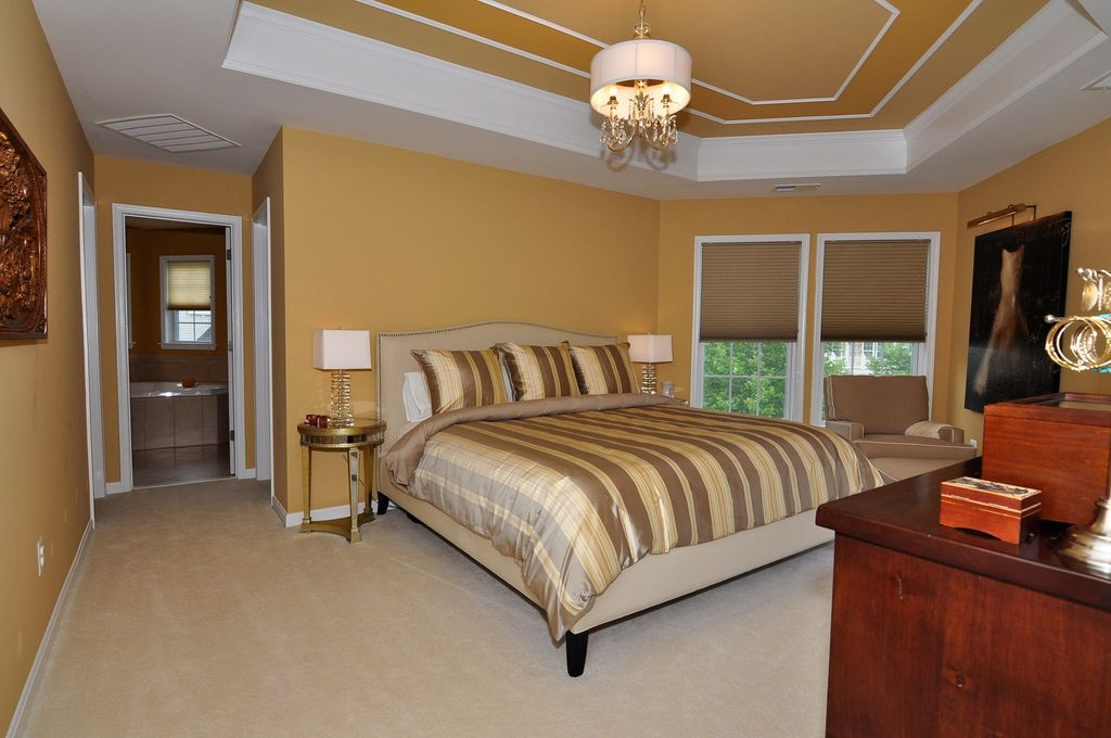 Traditional Master Bedroom with Standard height, Chandelier, picture window, Crown molding, Carpet