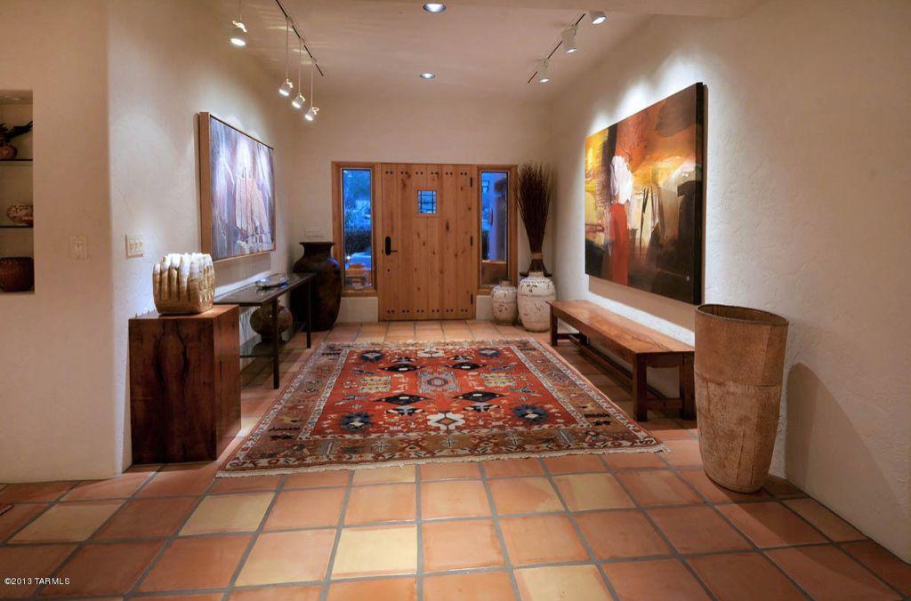Eclectic Entryway with Built-in bookshelf, can lights, Glass panel door, picture window, Pendant light, Standard height