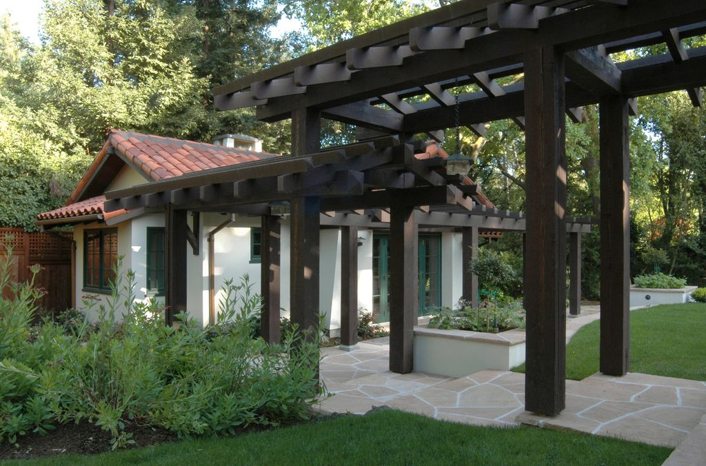 Mediterranean Landscape/Yard with Pathway, French doors, Raised beds, Casement, Arbor, exterior stone floors, Fence