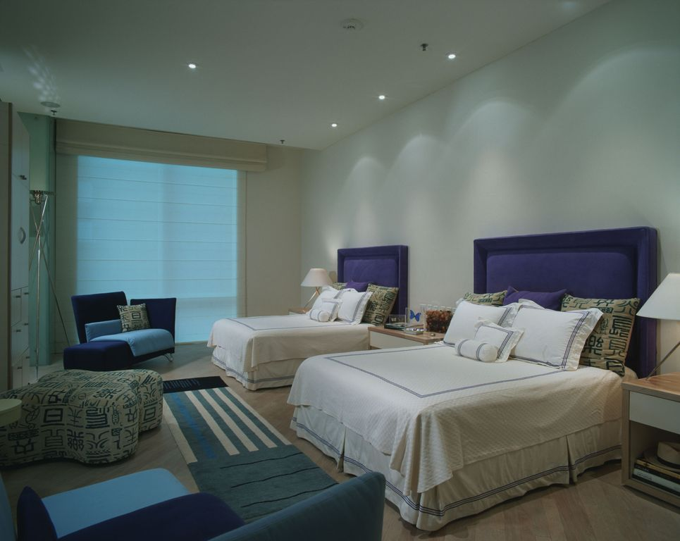 Contemporary Guest Bedroom with Standard height, Laminate floors, can lights, picture window