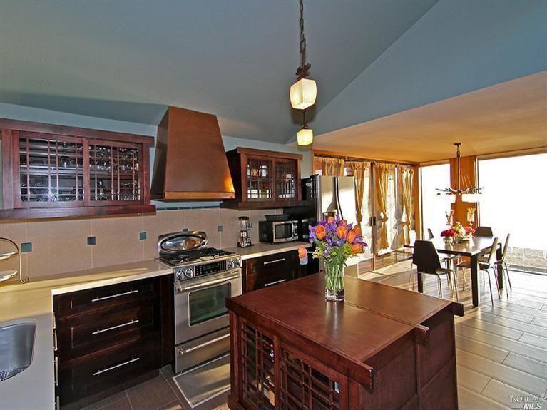 Contemporary Kitchen with Glass panel, Standard height, Copper range hoods, Limestone Tile, sliding glass door, gas range