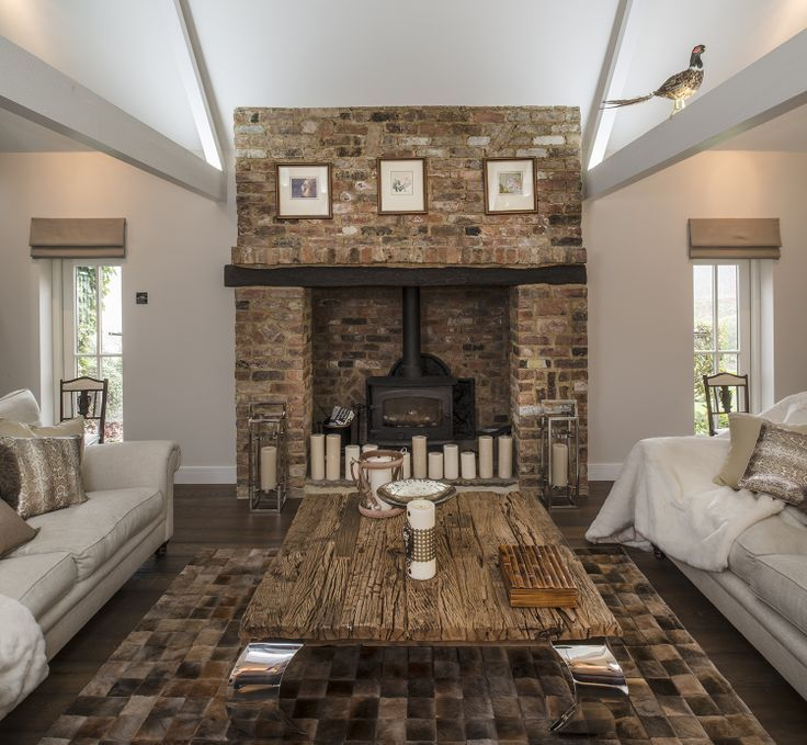 Rustic Living Room with Casement, Hardwood floors, Fireplace, High ceiling, Wood Stove fireplace, Exposed beam