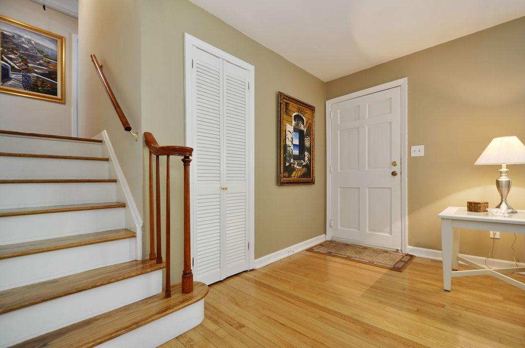Traditional Entryway with Built-in bookshelf, Hardwood floors, Wood table, Box door