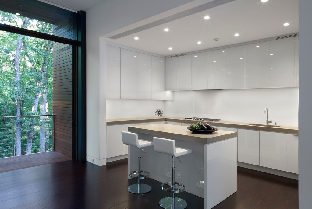 Modern Kitchen with L-shaped, Standard height, Undermount sink, Limestone counters, Breakfast bar, electric cooktop, Balcony