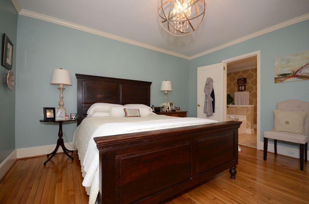 Traditional Master Bedroom with Hardwood floors, specialty door, Crown molding, Standard height, Chandelier