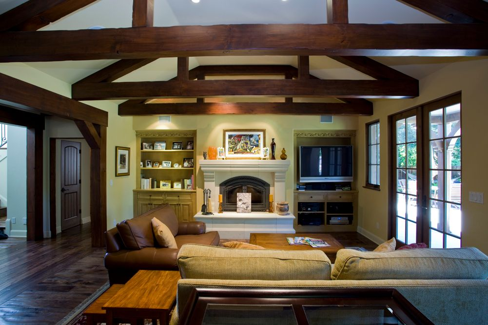 Country Great Room with can lights, Fireplace, Built-in bookshelf, Casement, High ceiling, French doors, Exposed beam