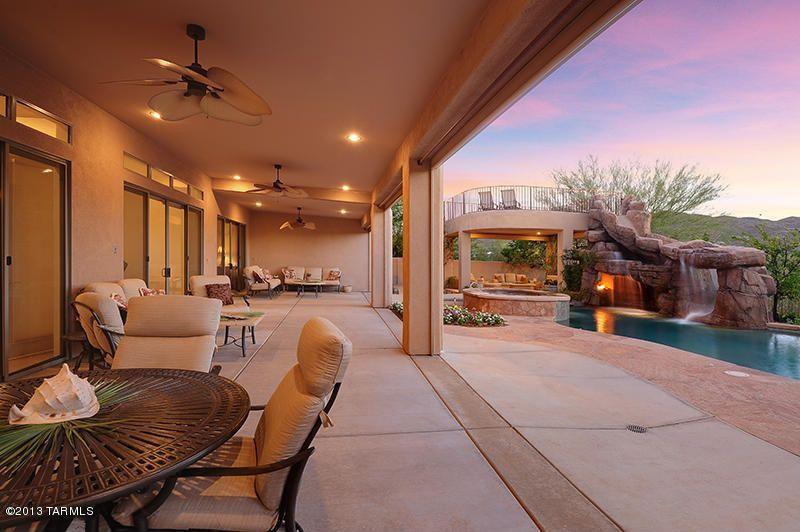 Mediterranean Porch with Deck Railing, exterior tile floors, exterior concrete tile floors, Transom window, Fence