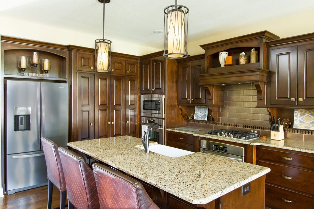 Traditional Kitchen with wall oven, Inset cabinets, Pendant light, Breakfast bar, Farmhouse sink, Subway Tile, Custom hood