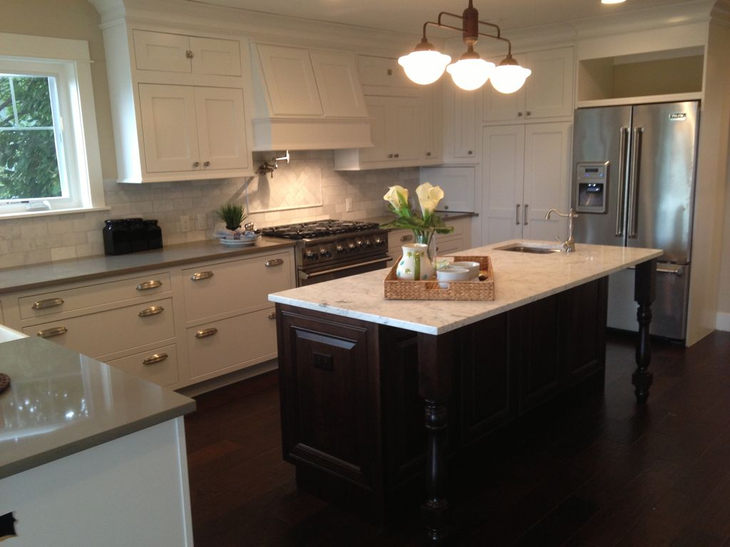 Traditional Kitchen with Stainless steel cup pull, Custom hood, Complex marble counters, full backsplash, European Cabinets