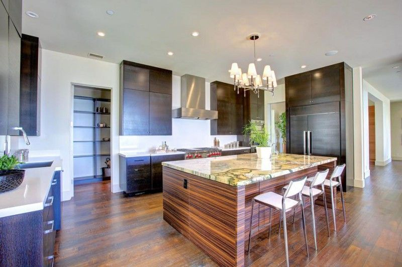 Contemporary Kitchen with electric cooktop, Complex marble counters, Breakfast bar, Wall Hood, can lights, Undermount sink