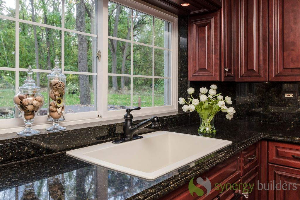 Traditional Kitchen with Quartz, full backsplash, drop-in sink, Quartz counters, Framed Partial Panel, Raised panel, Casement